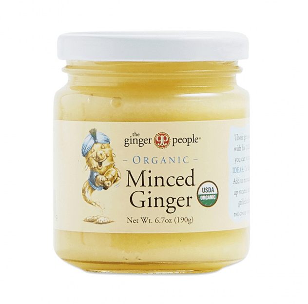 Small glass jar of organic minced ginger with a white lid and yellow label.