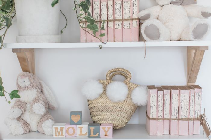 Daughter Molly's bedroom décor includes stuffed animals and blush colored books