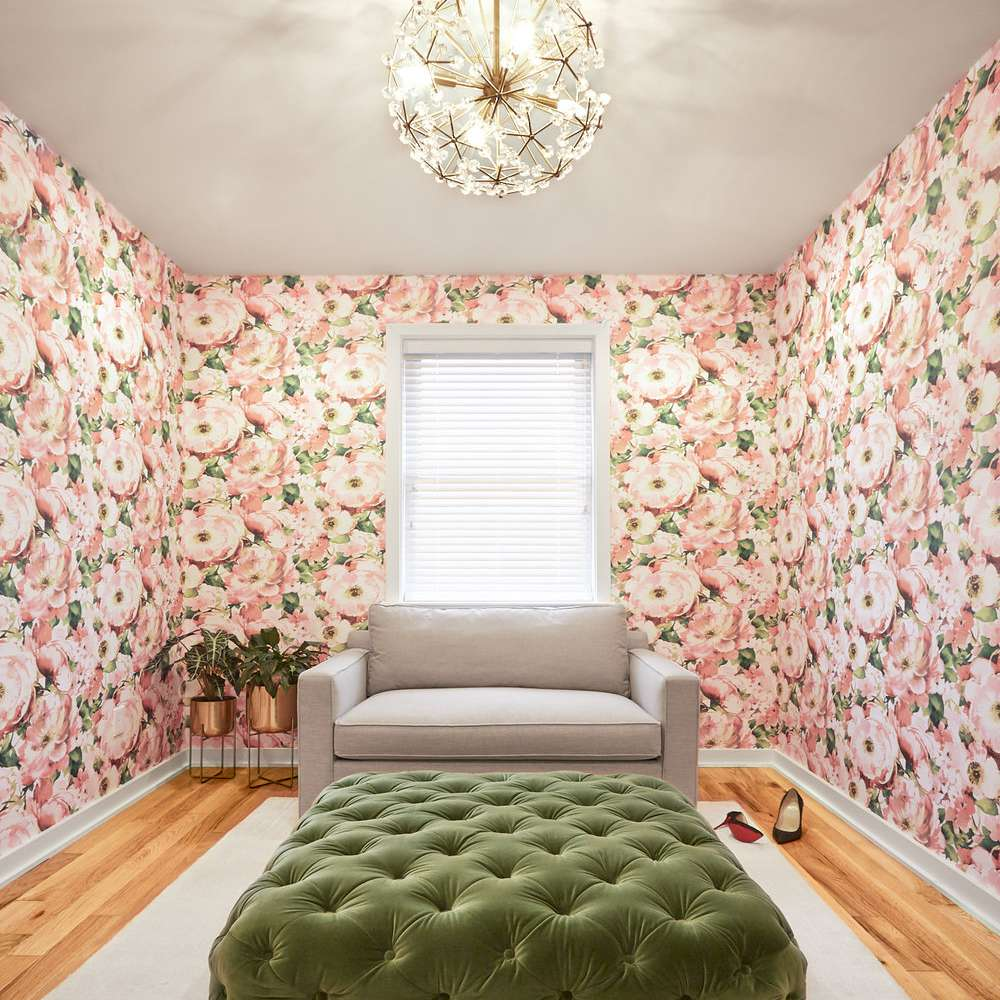 Floral-wallpapered room with green tufted ottoman
