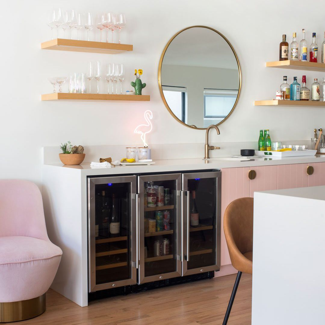 Modern home bar with blush and gold accents