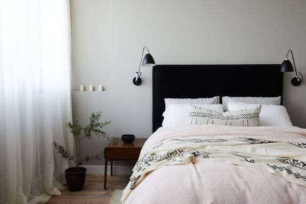 Bedroom with black bed frame