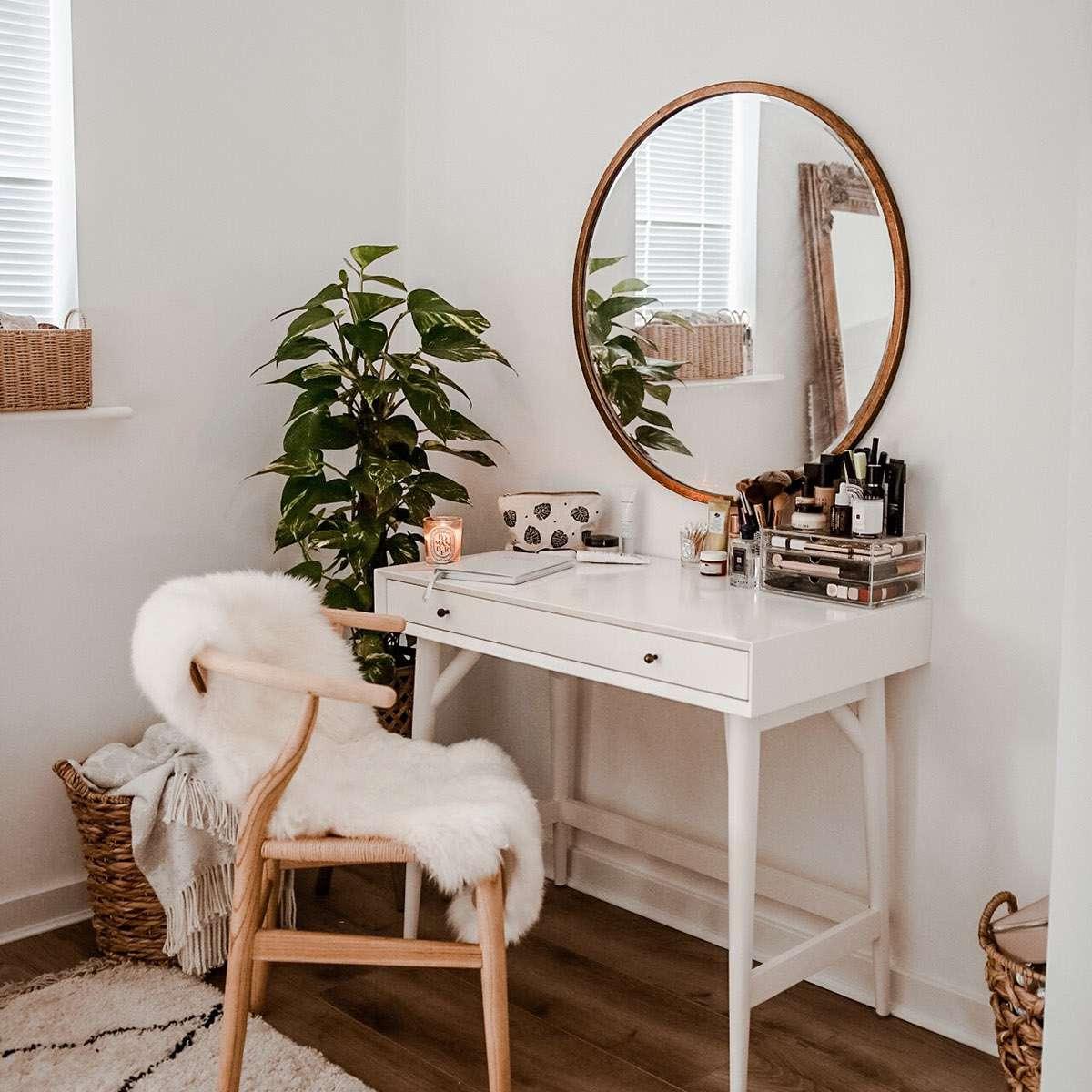 Sweet boho vanity with large round mirror and wishbone chair.