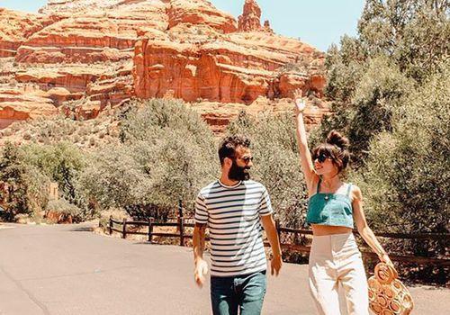 man and woman walking in Sedona