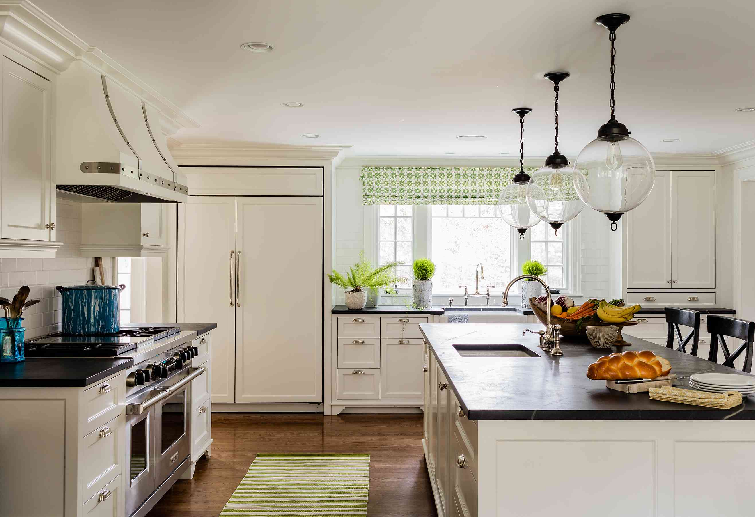 White kitchen with green gingham accents.