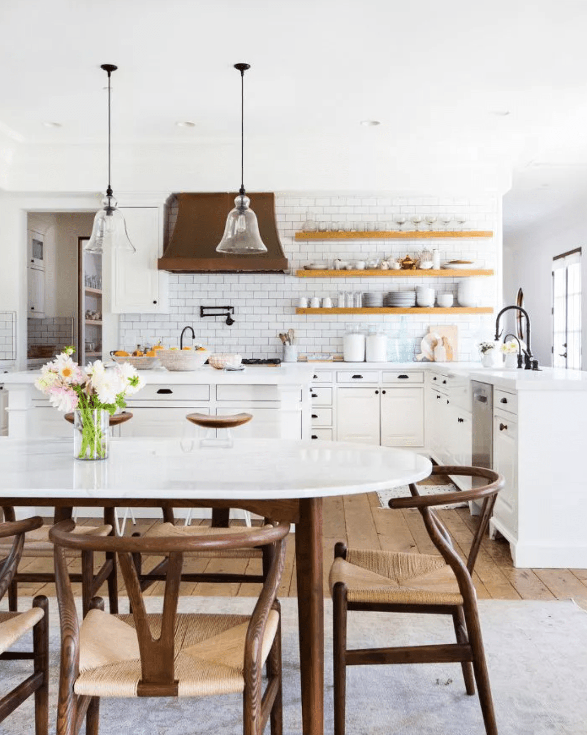 All white kitchen with floating wooden shelves