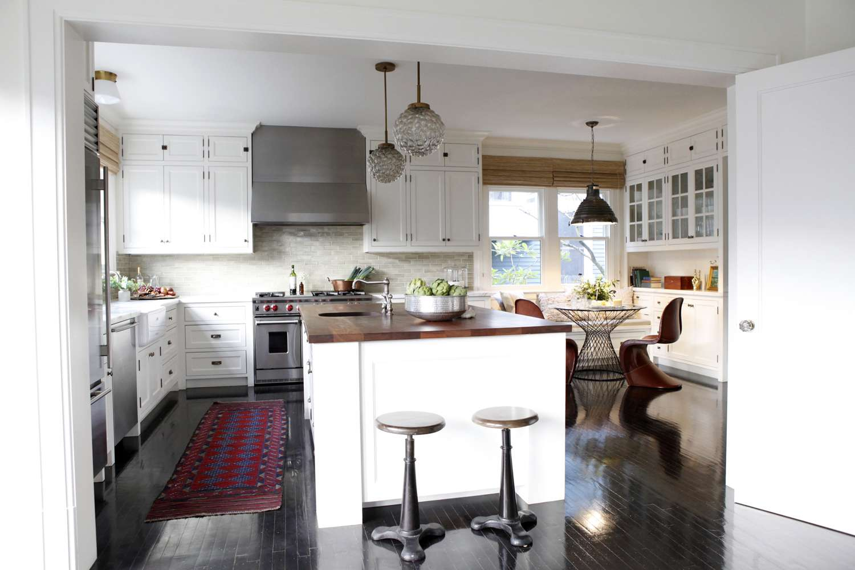 red kitchen rug in white kitchen