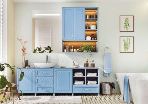 A serene bathroom with Wild Blue Yonder painted cabinets.