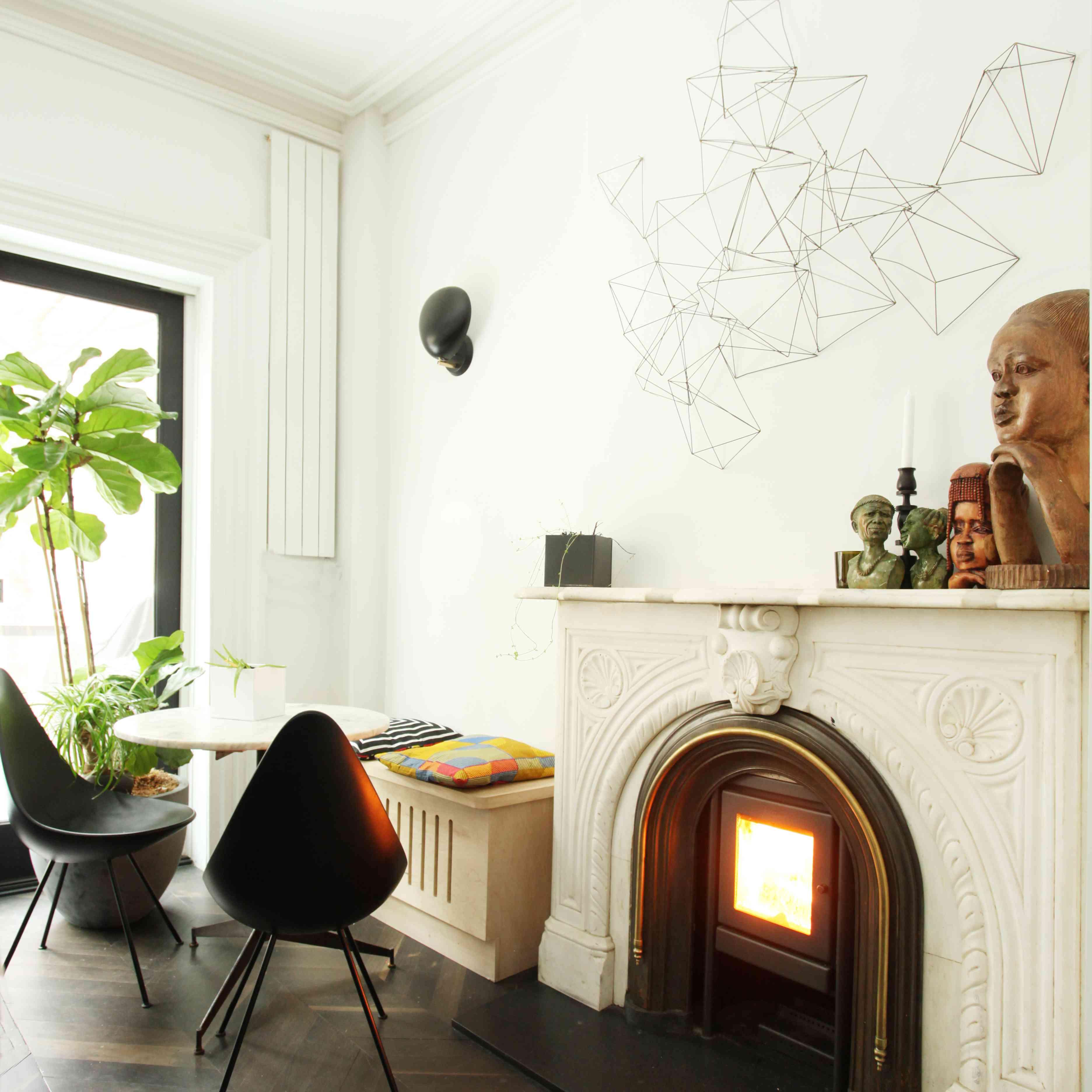 fireplace with modern wall art