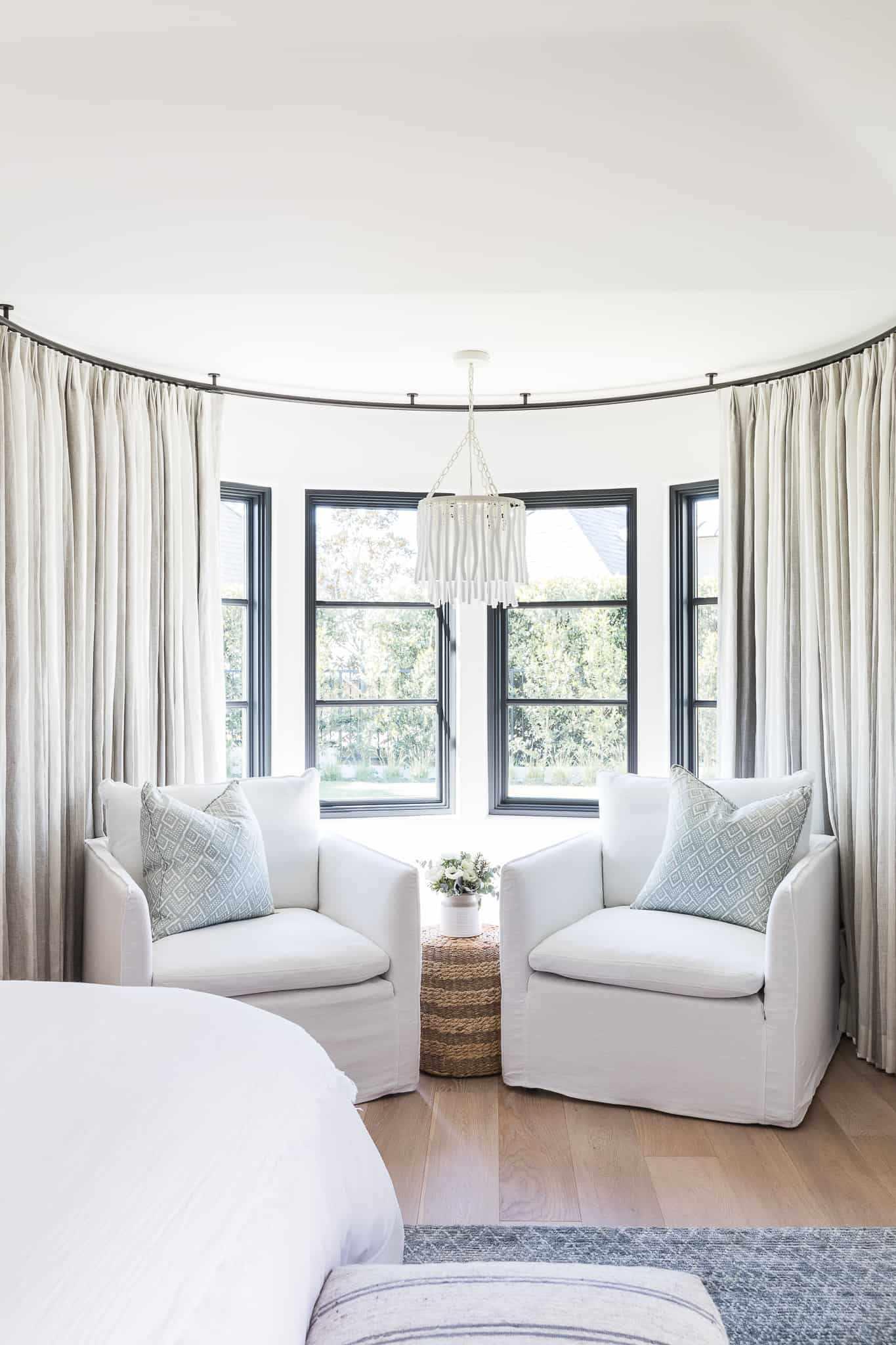 A bay window with custom drapes
