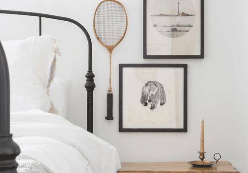 Bedroom with vintage art.