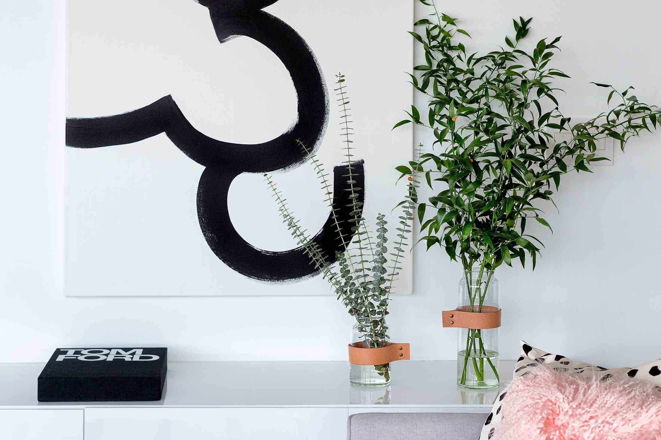 Modern apartment decor: art, vases, and a book