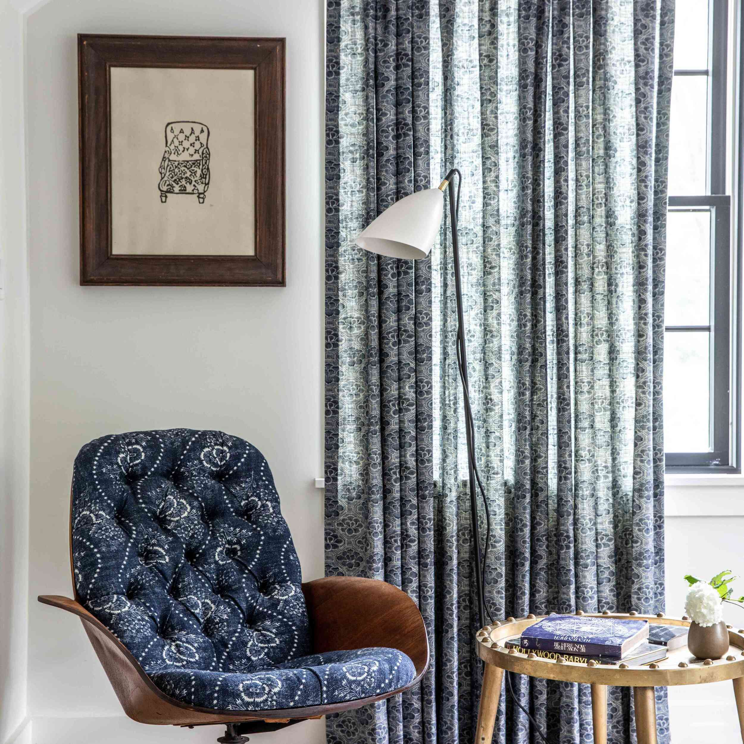 A room with indigo curtains and an indigo chair