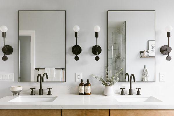 Double vanity with slim mirrors.