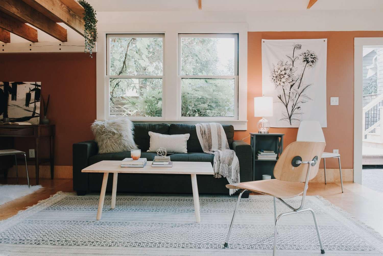 Black sofa in peach living room.