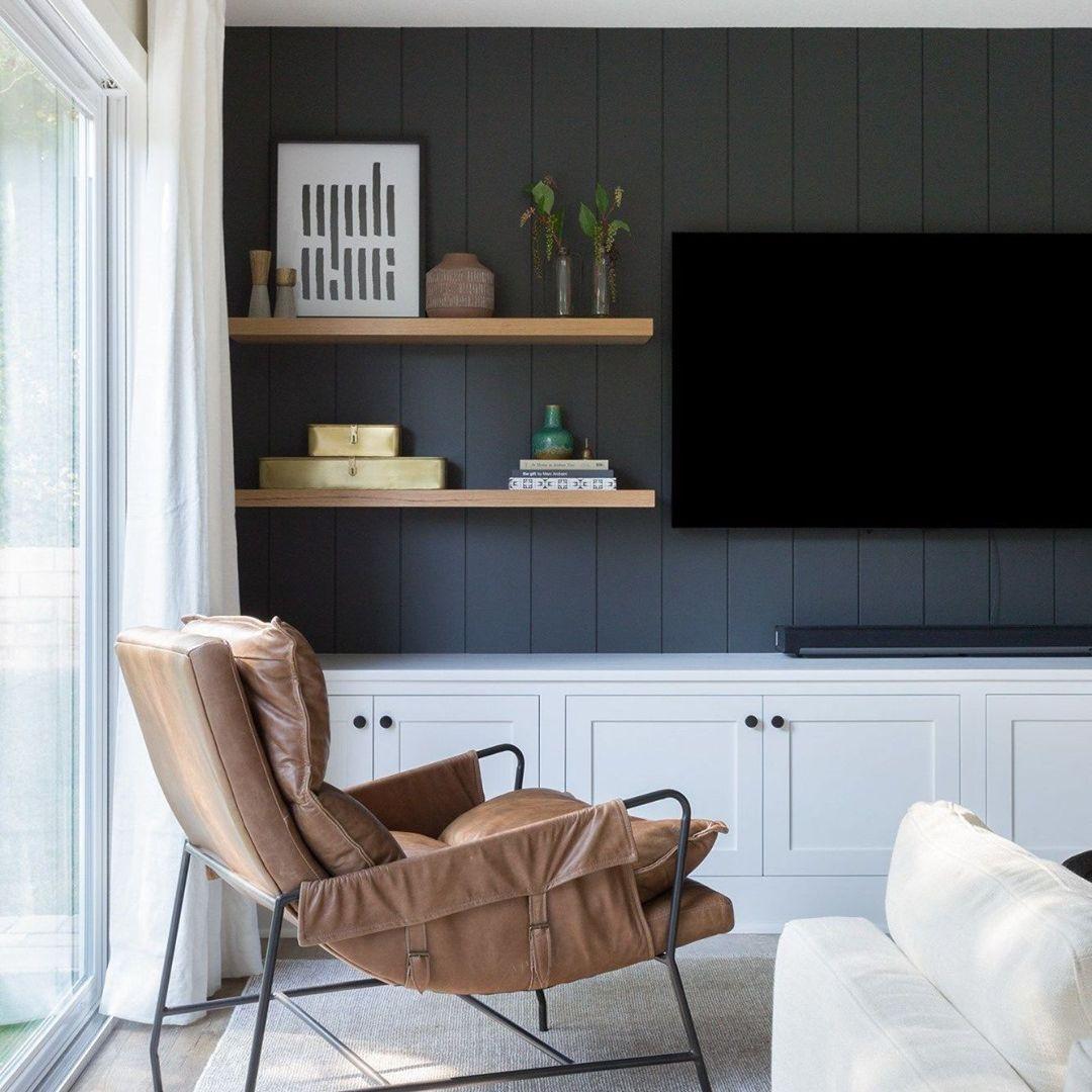 Gray wood paneling in den