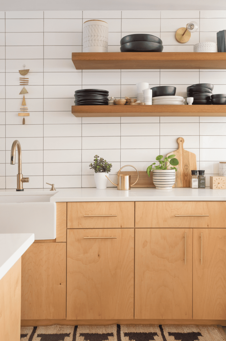 A minimalist kitchen backsplash, crafted from white tiles that have been arranged in an orderly grid