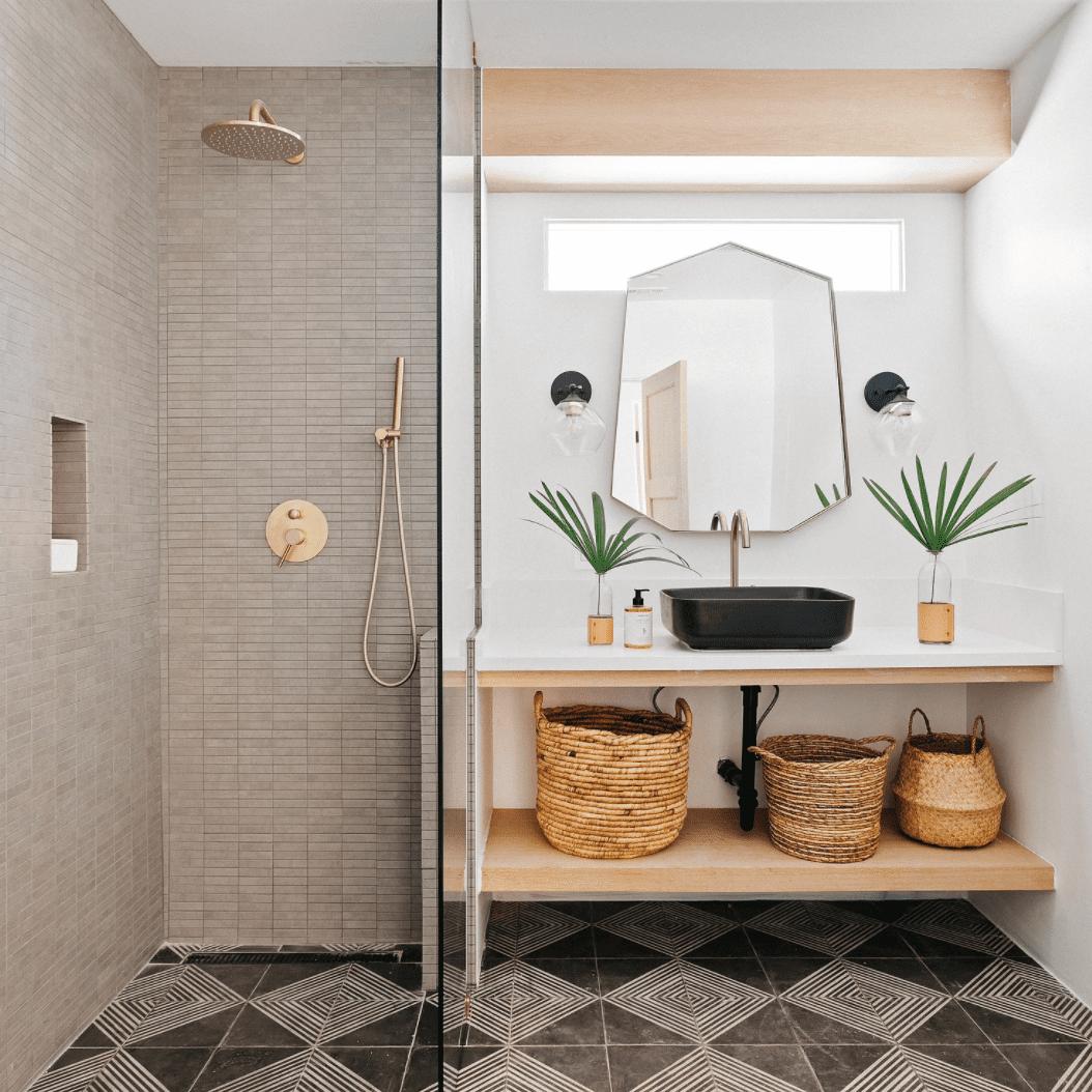 A master bathroom with bold geometric tiles