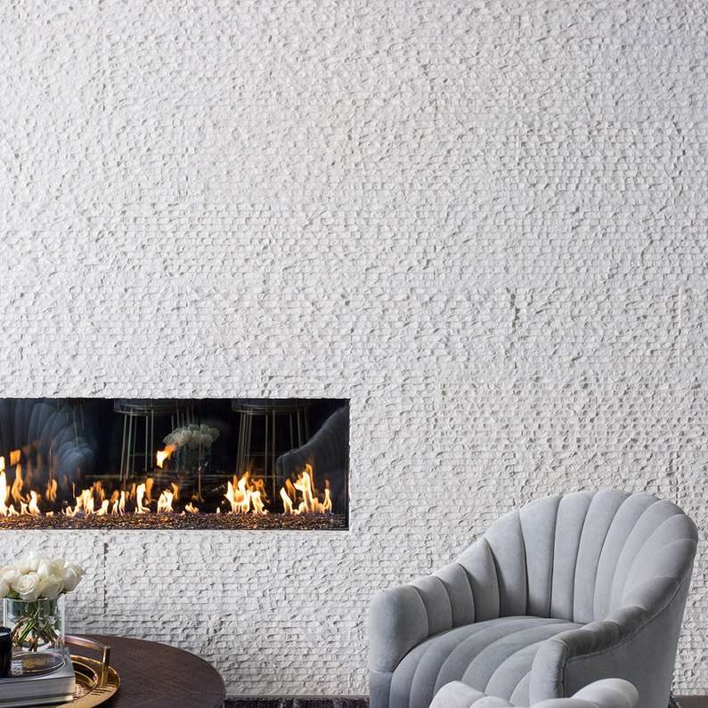 Ultra modern living room with full stone feature wall and inset fireplace