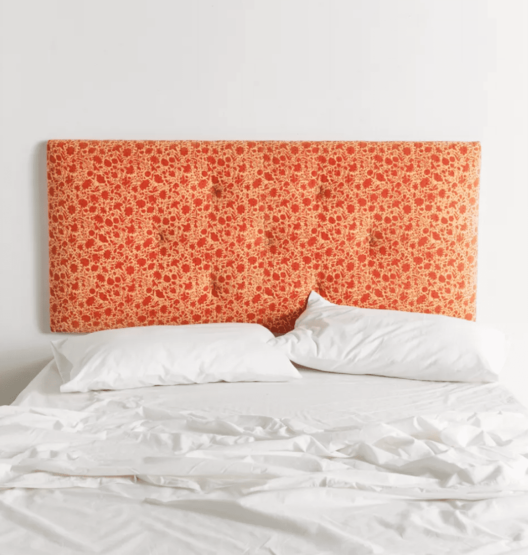 A tufted floral headboard, currently for sale at Urban Outfitters
