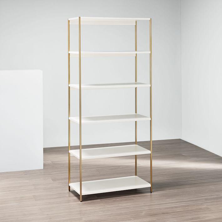 gold and white bookshelf