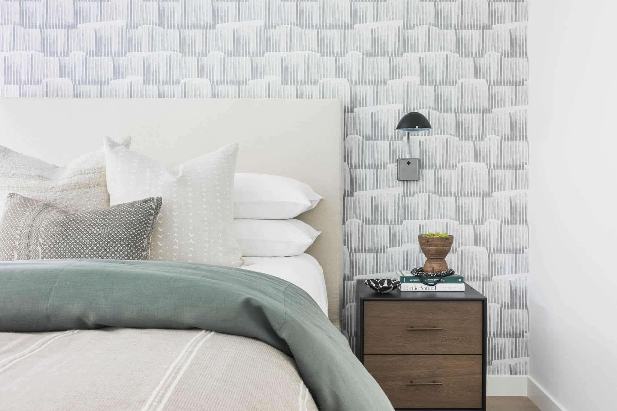 White bedroom with wallpaper