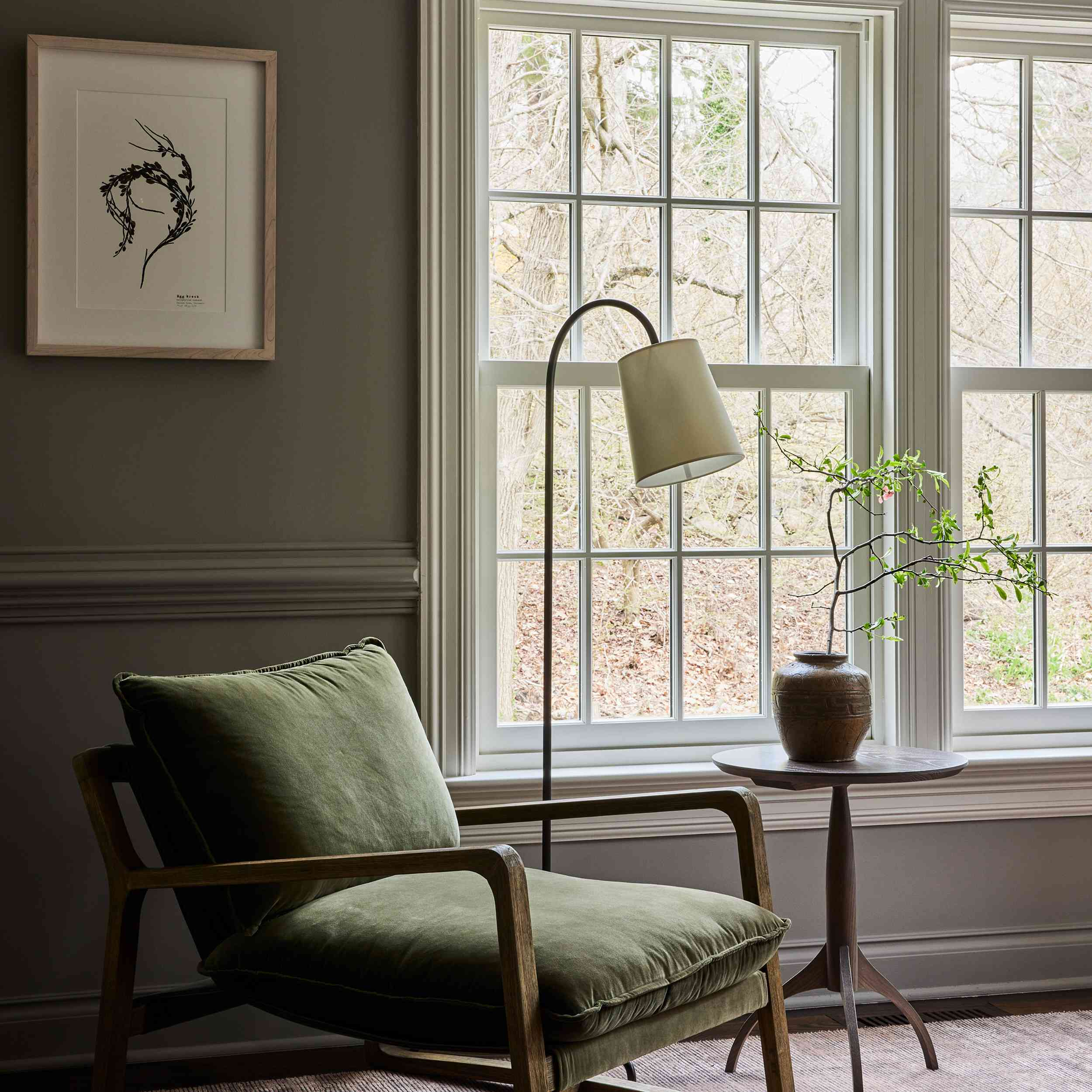 connecticut farmhouse home tour - her office with green chair and reading lamp
