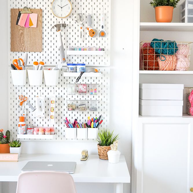 A minimalist craft room lined with white organization essentials and craft supplies