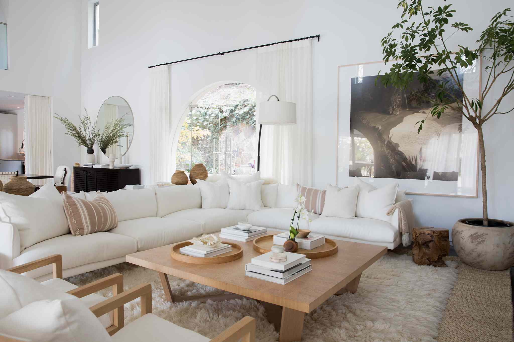 Neutral living room with wooden coffee table.