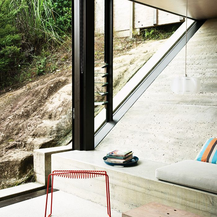 Modern room featuring raw concrete surfaces