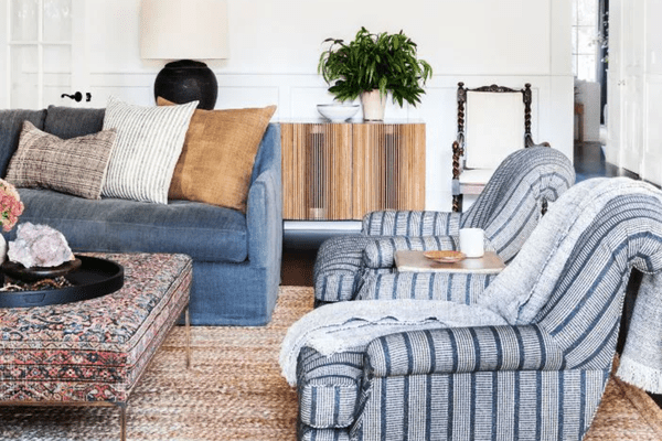 Living room with natural woven rug and blue arm chairs