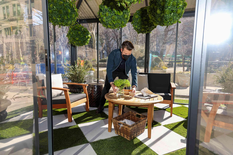 Nate Berkus styling his New York pop-up greenhouse.