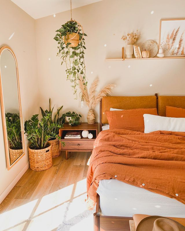 zz plant and pothos in a bright boho bedroom