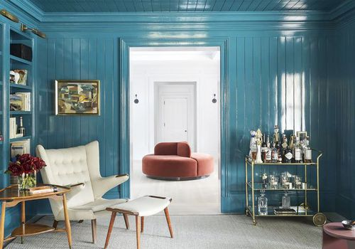 A sitting area painted from top to bottom in Behr's Blueprint, its 2019 paint color of the year.