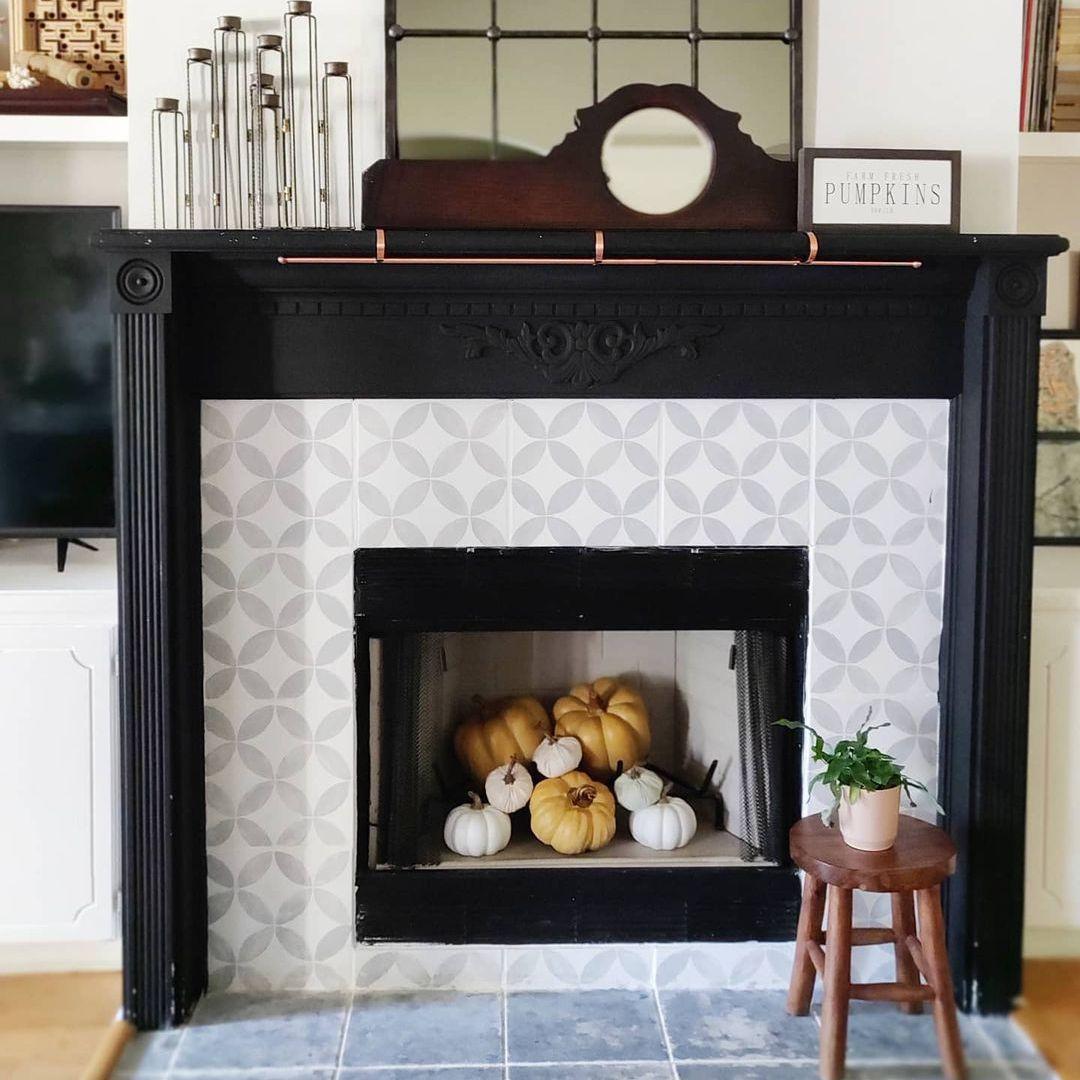 fireplace with pumpkins inside