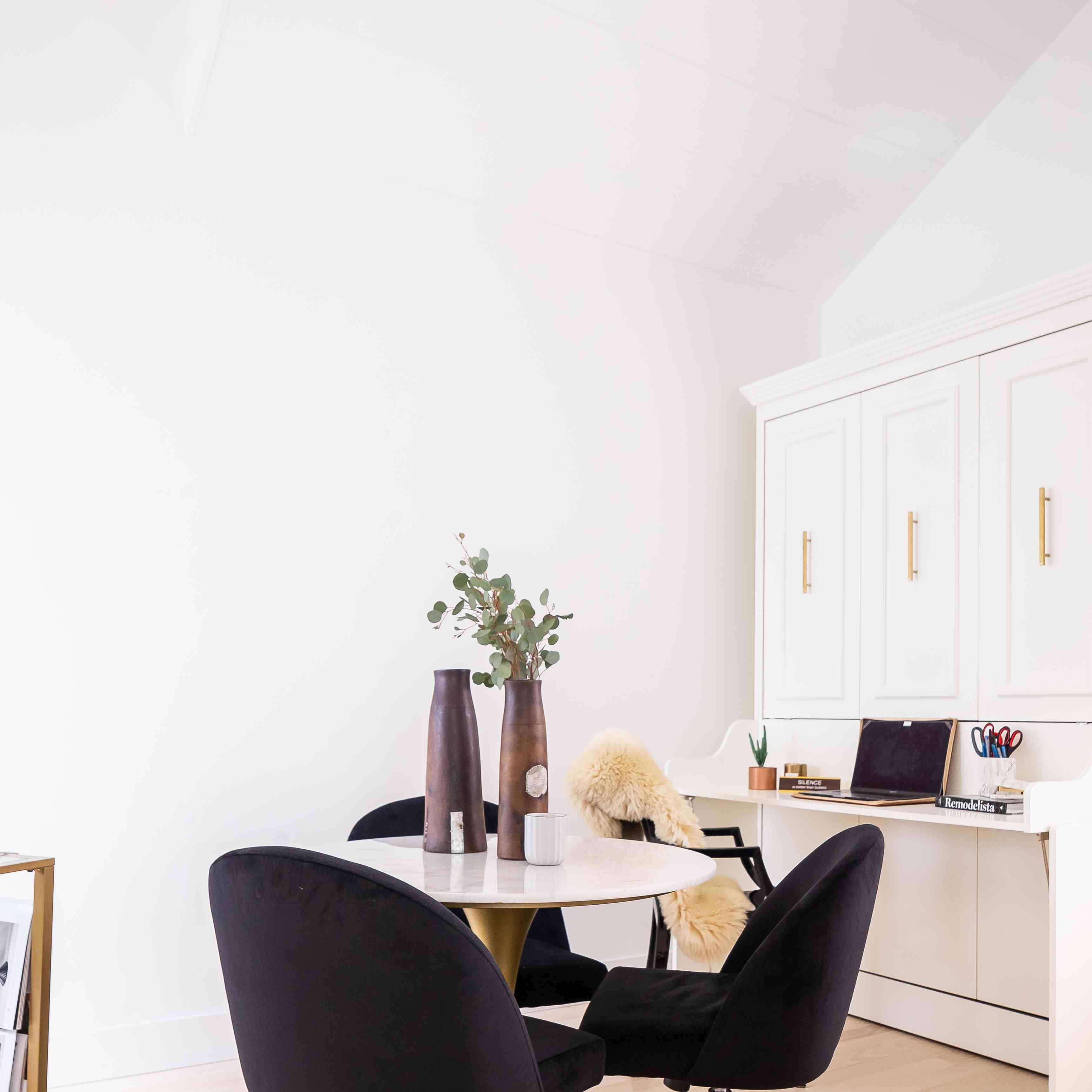 Simple office space with black rolling chairs.