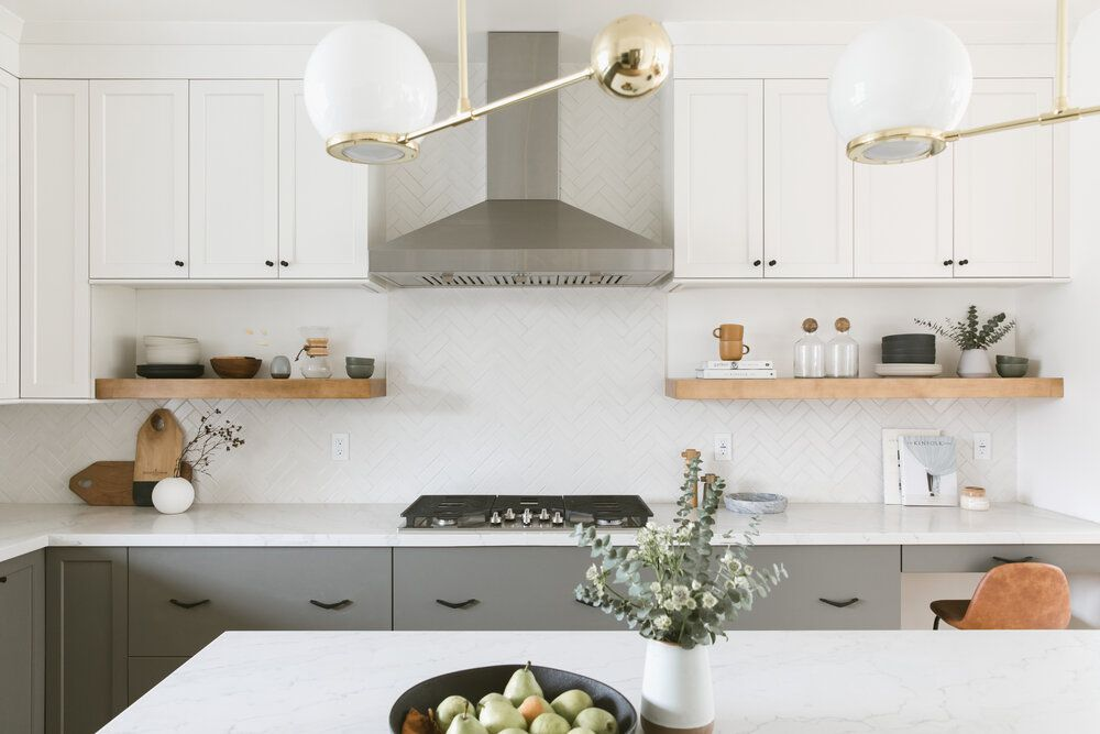 A minimalist kitchen with white and gray kitchen cabinets