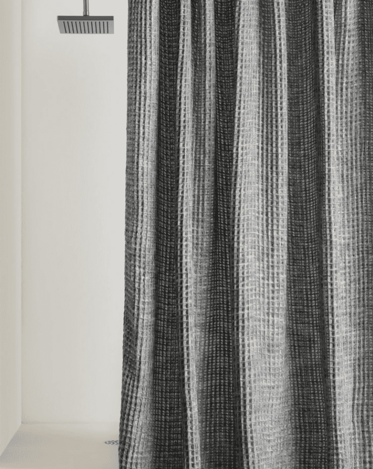 A gray waffle shower curtain