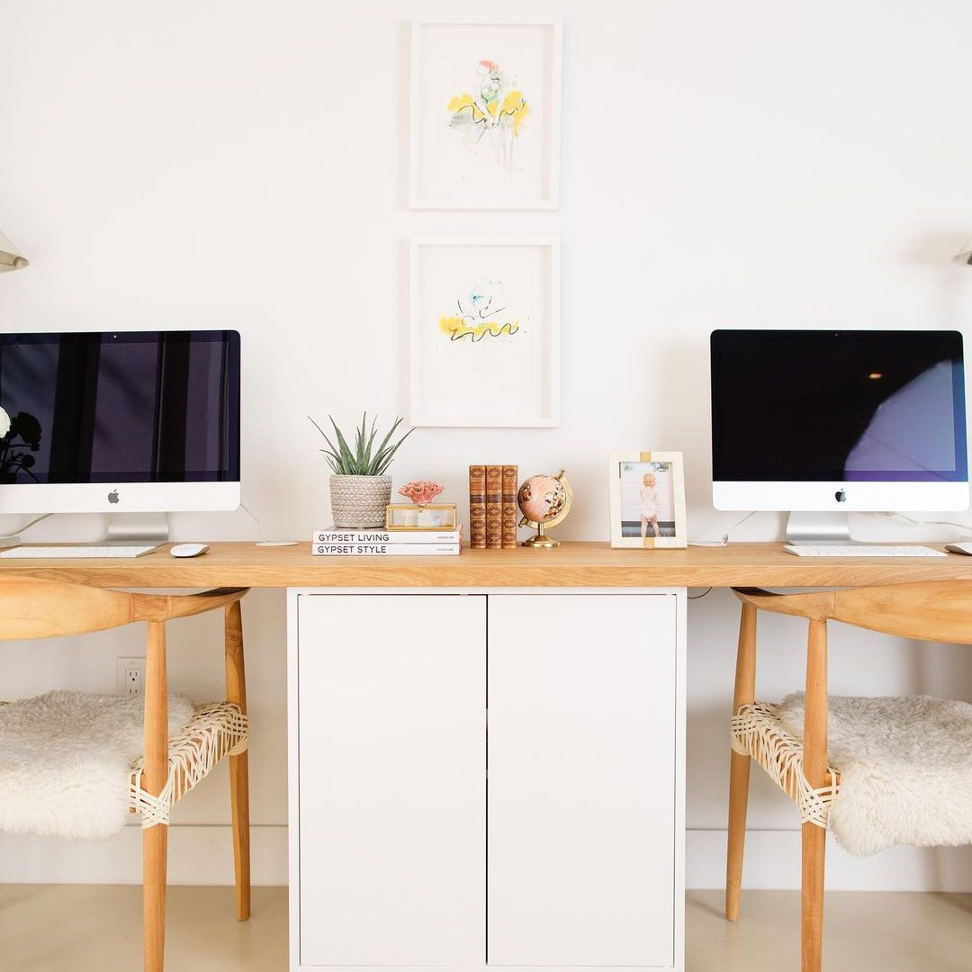 Two monitors on a desk