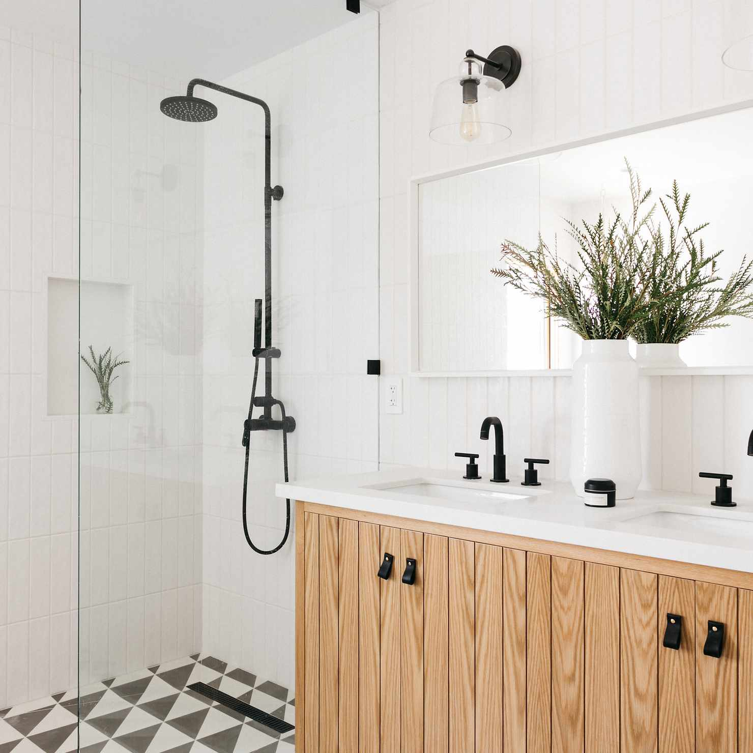 Modern bathroom with geometric tiles and wood vanity