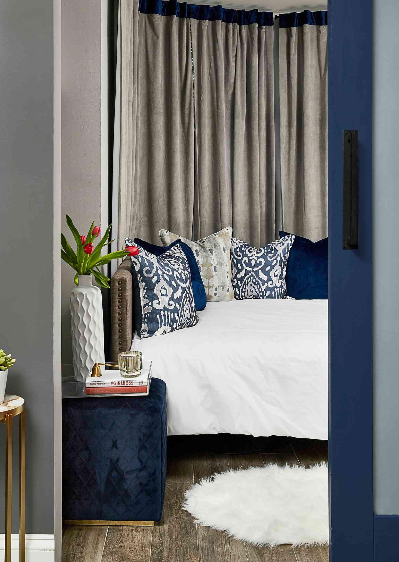 Duke Ellington home tour - cozy guest room with navy accents