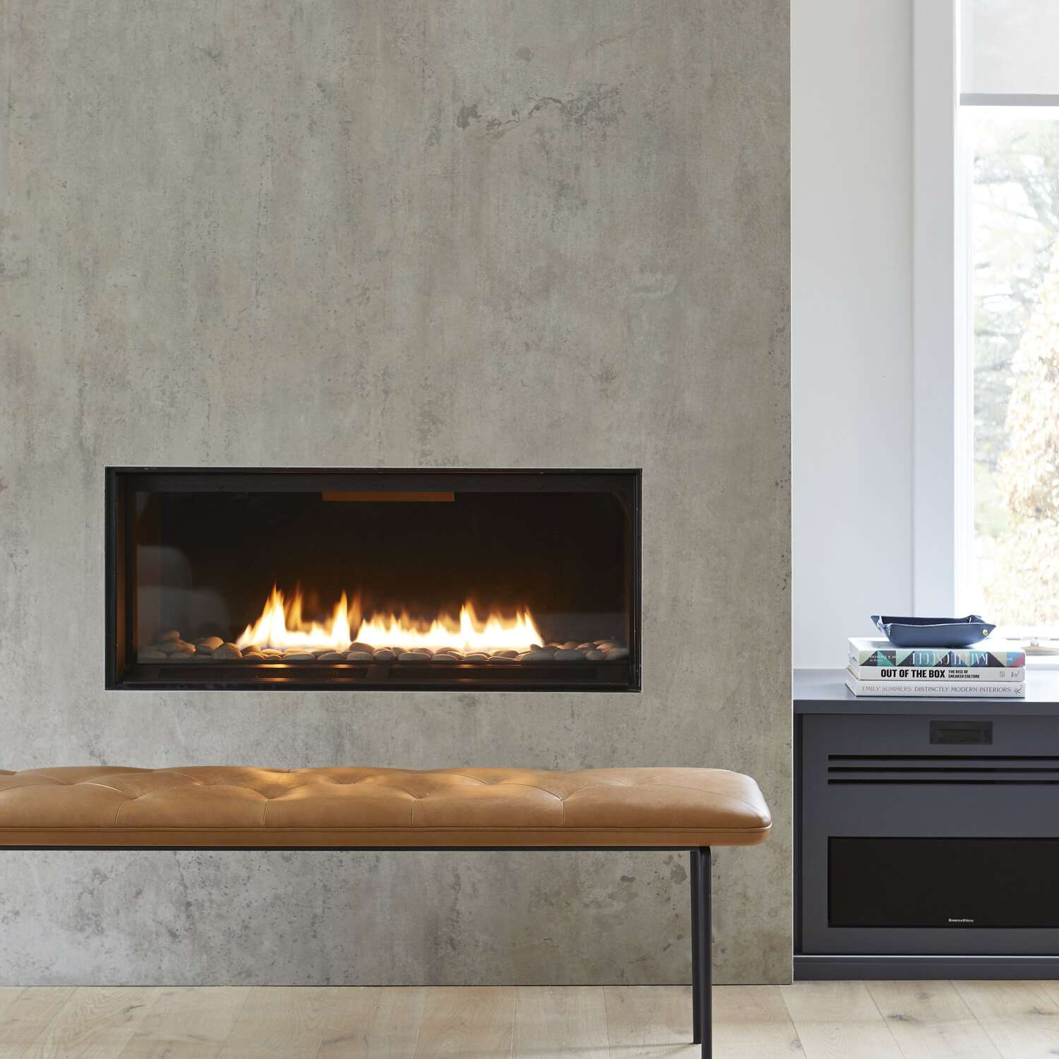 A living room with a cement fireplace