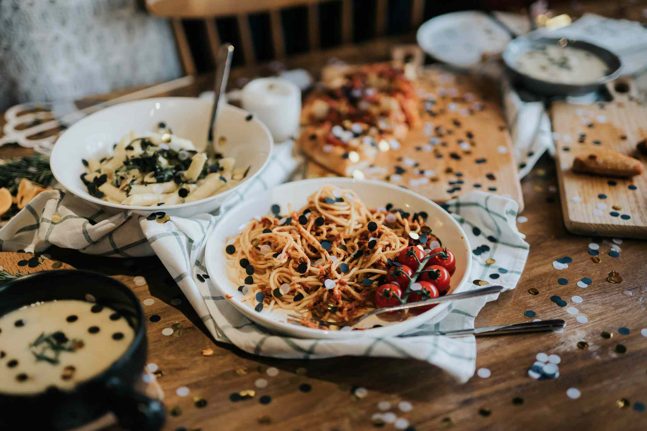 Dinner spread with confetti strewn across table