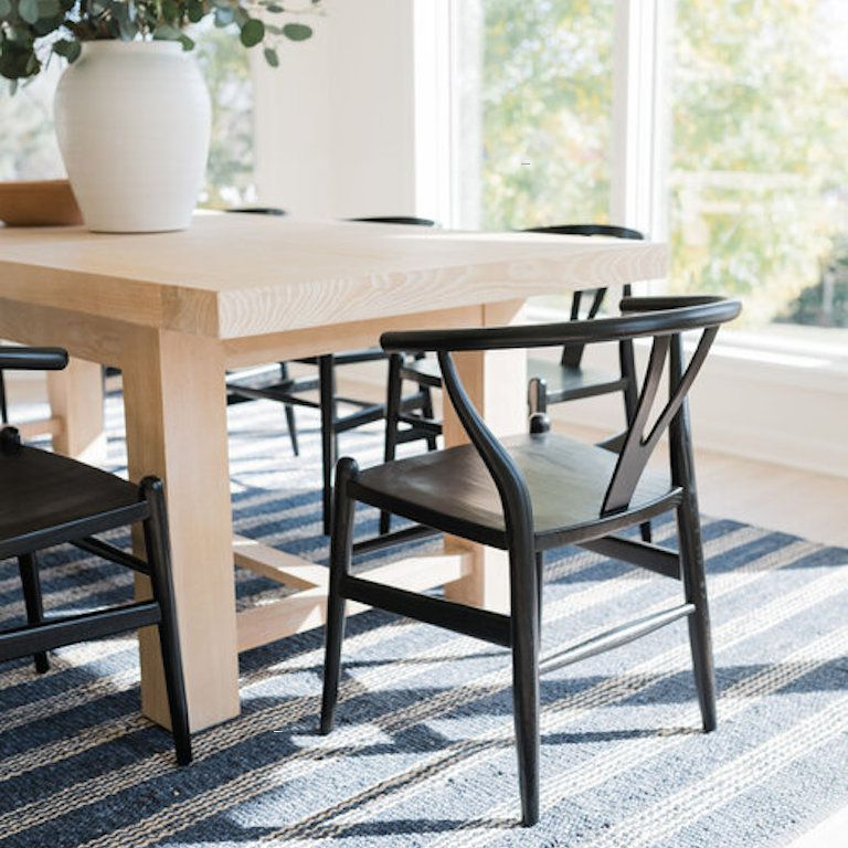 Dining table featuring wishbone chair