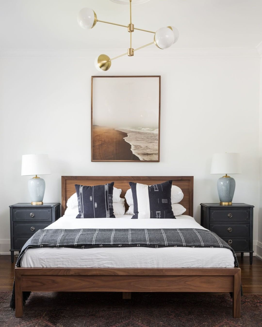 Bedroom with light fixture above bed