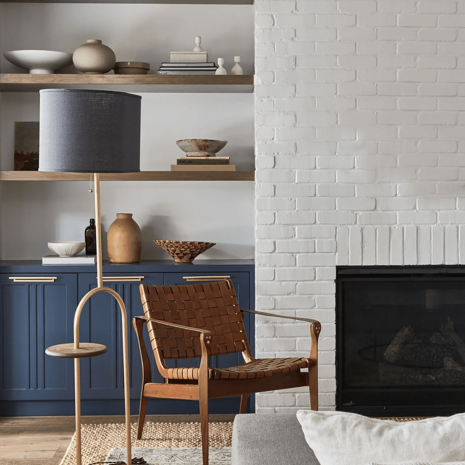 A living room with a pop of indigo cabinetry