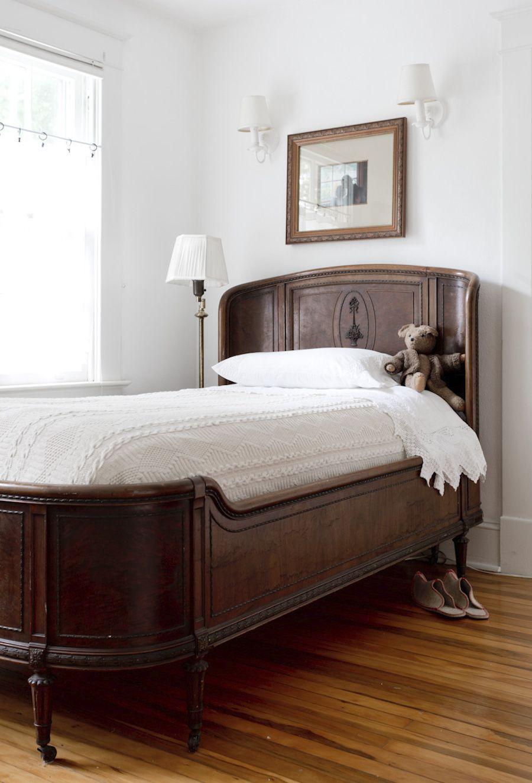 An antique wooden bed