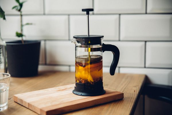Close-up of French press coffeemaker sitting on a countertop