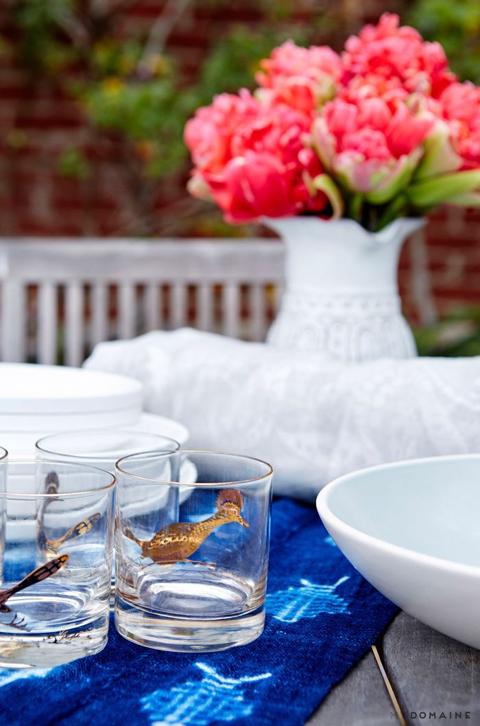 Casual outdoor table setting with indigo table cloth