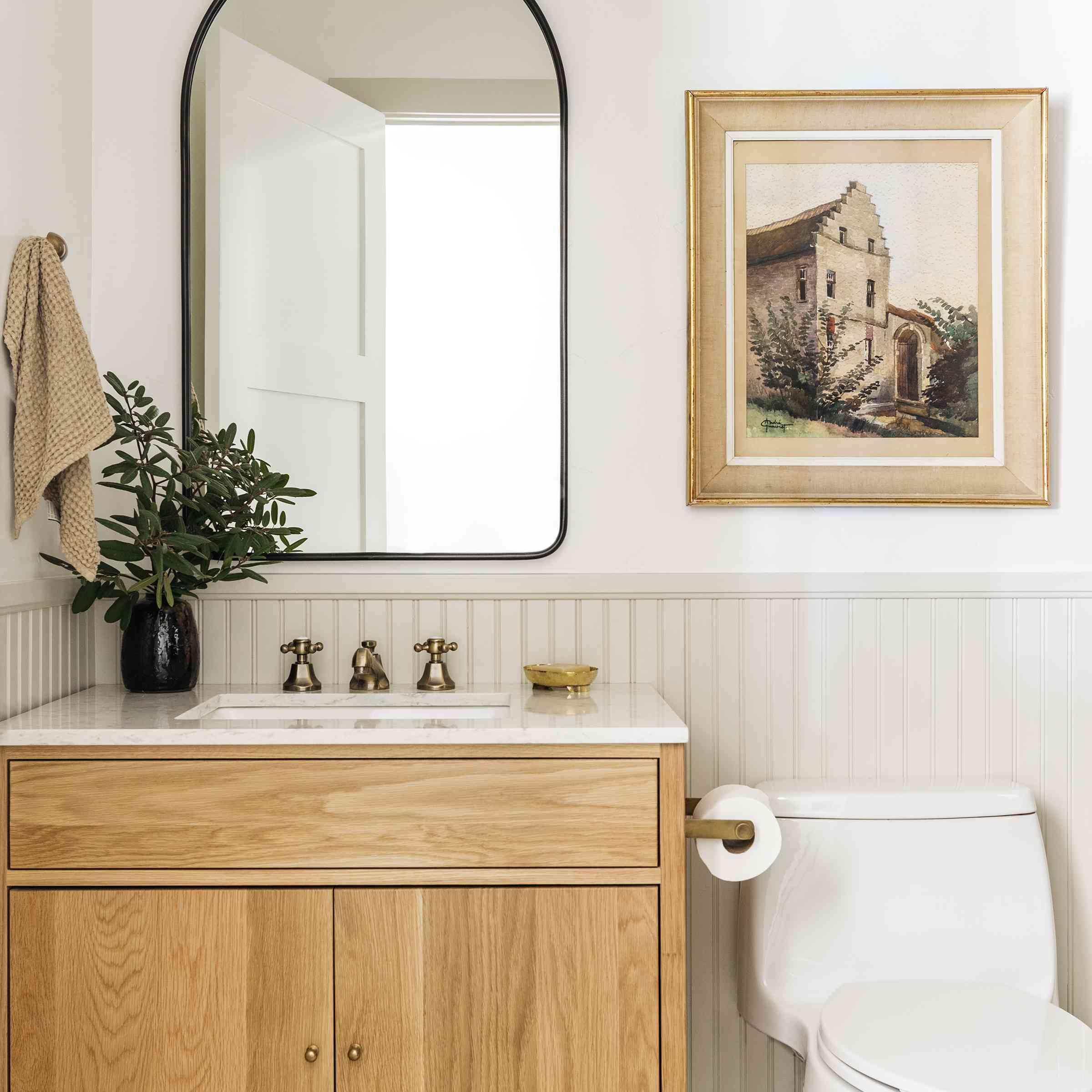 Brett Foken home tour - bathroom with beadboard art and wooden vanity