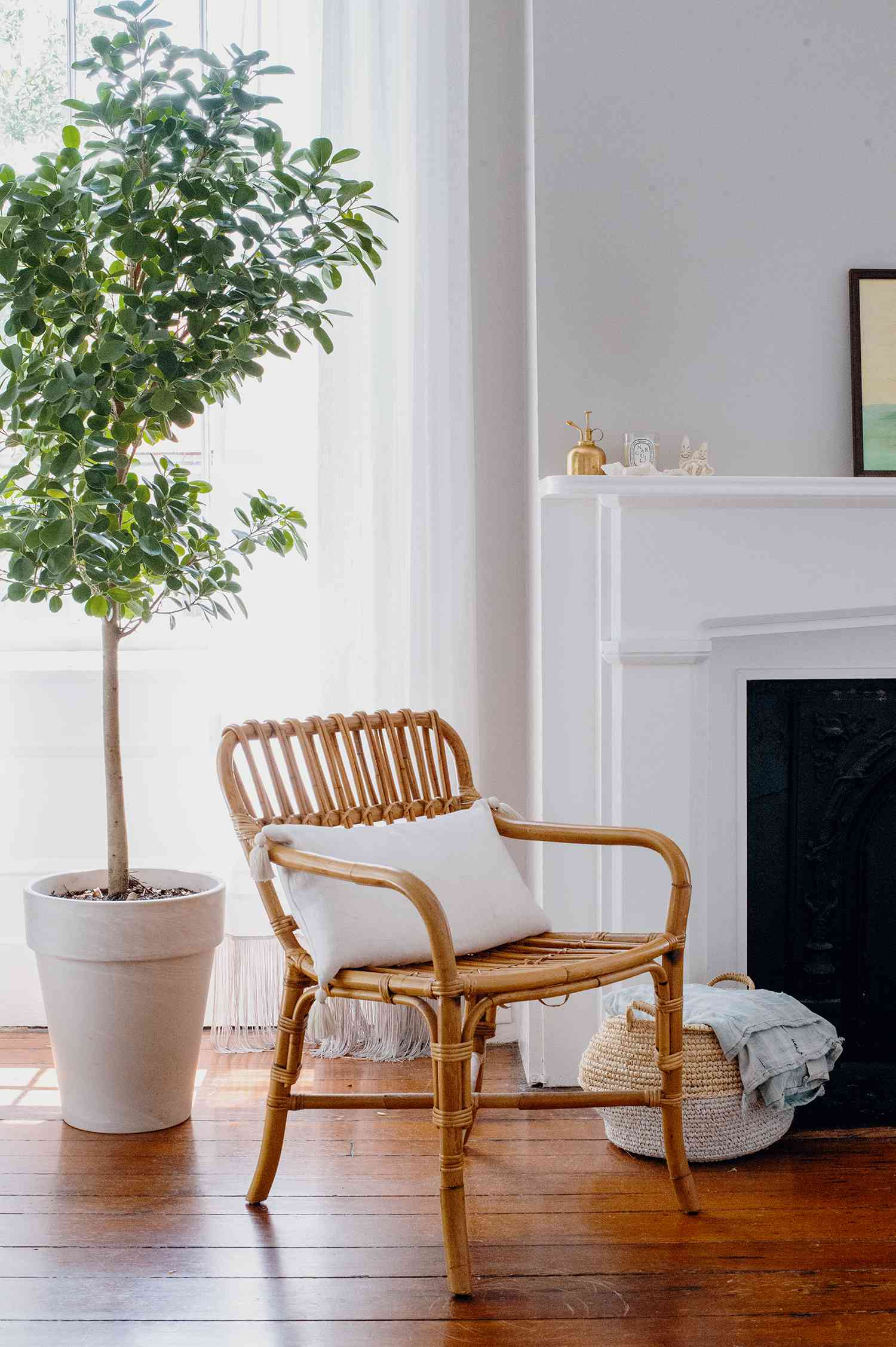 Amanda Greeley home tour - bedroom with fireplace and vintage rattan chair